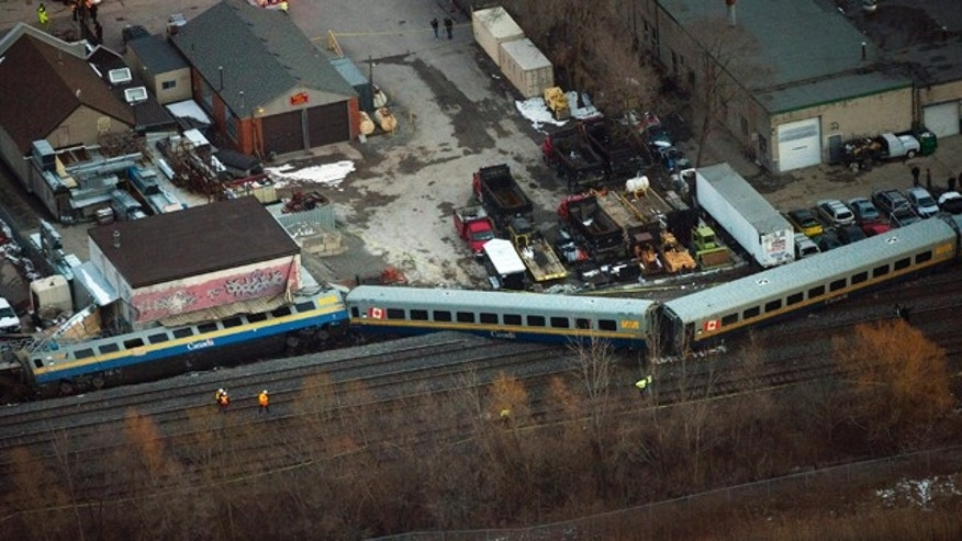 Feb. 26, 2012: Emergency crews work the scene of a Via Rail train derailment in Burlington, Ontario, west of Toronto.