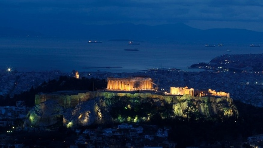 Feb. 8: The ancient Acropolis hill with the Parthenon temple is illuminated above Athens.