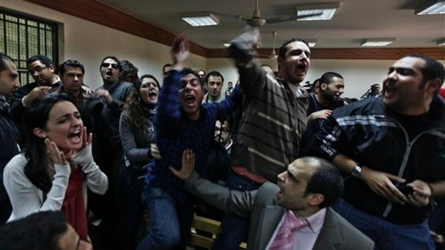Feb. 26: Egyptian protesters chant anti-military ruling slogans during a trial of employees of pro-democracy groups charged with using foreign funds to foment unrest in Cairo, Egypt.