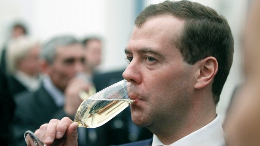 Feb. 22: Russian President Dmitry Medvedev drinks champagne during an award ceremony in the Kremlin.