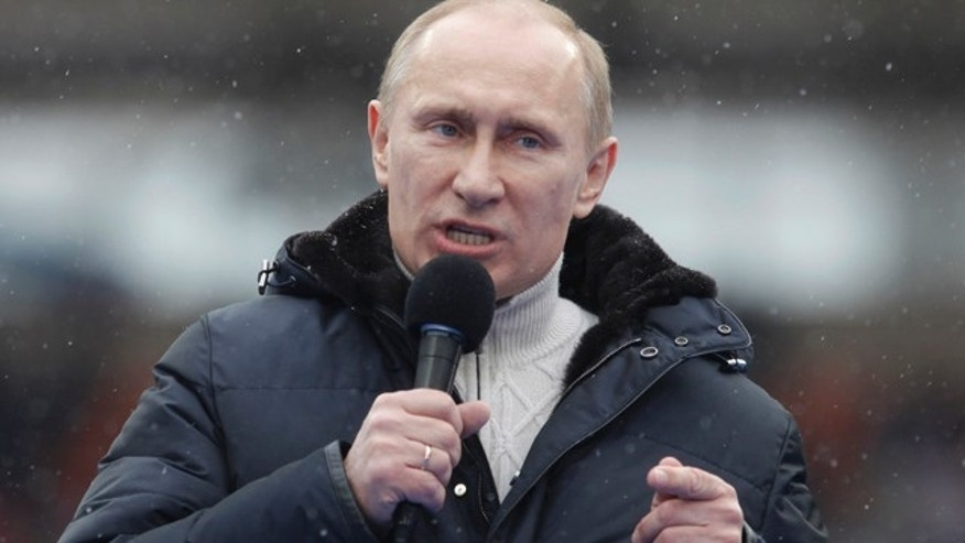 Feb. 23: Russian Prime Minister Vladimir Putin attends a massive rally in his support at Luzhniki stadium in Moscow,  Russia.