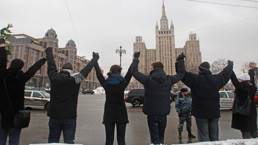 Feb. 16: People stand along Garden Ring avenue holding hands during opposition protest in Moscow. Thousands of people are holding hands to form a 10-mile human chain encircling central Moscow in the latest protest against Russian Prime Minister Vladimir Putin.