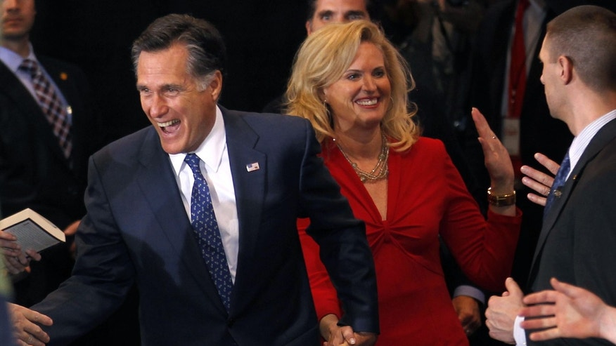 Republican presidential candidate former Massachusetts Gov. Mitt Romney arrives with his wife Ann at his election watch party after winning the Michigan primary in Novi, Mich., Tuesday, Feb. 28, 2012. (AP Photo/Gerald Herbert)