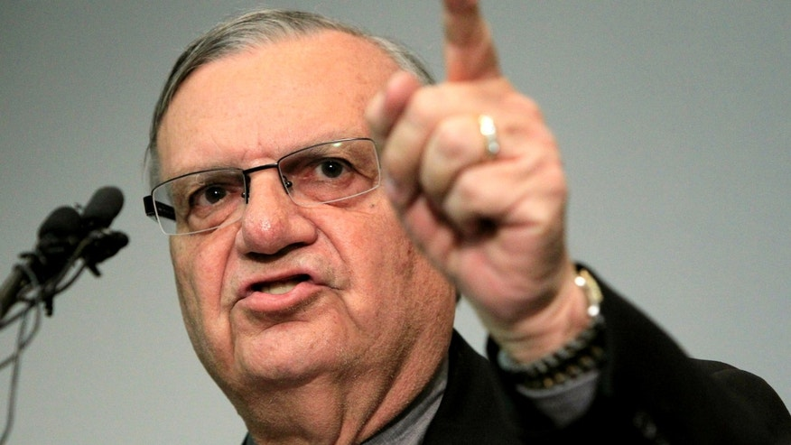 In this Dec. 21, 2011 file photo, Maricopa County Sheriff Joe Arpaio speaks to the media in Phoenix. (AP Photo/Ross D. Franklin, File)