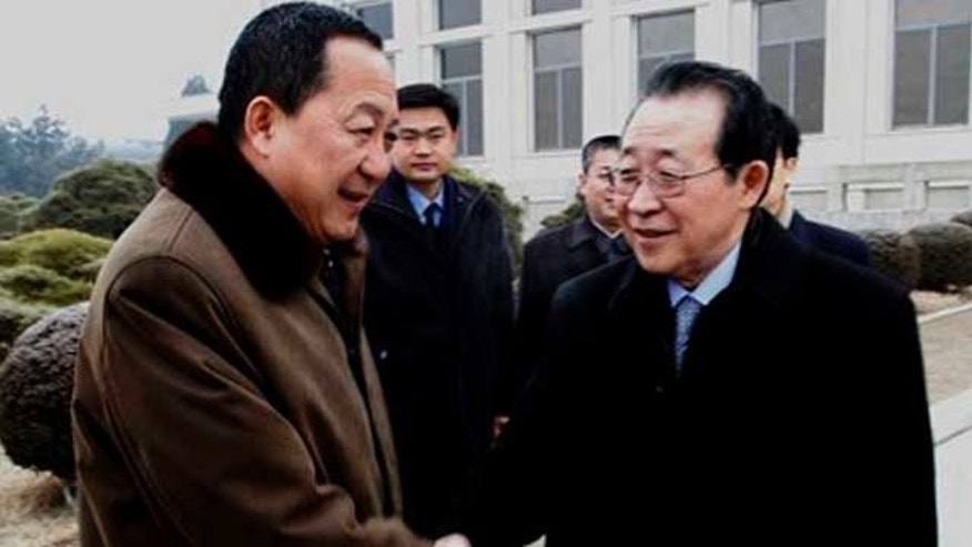 Feb. 27, 2012: North Korea's First Vice Foreign Minister Kim Kye Gwan, right, shakes hands with Ri Yong Ho, a Vice Minister of North Korea's Ministry of Foreign Affairs, at Pyongyang airport in North Korea.
