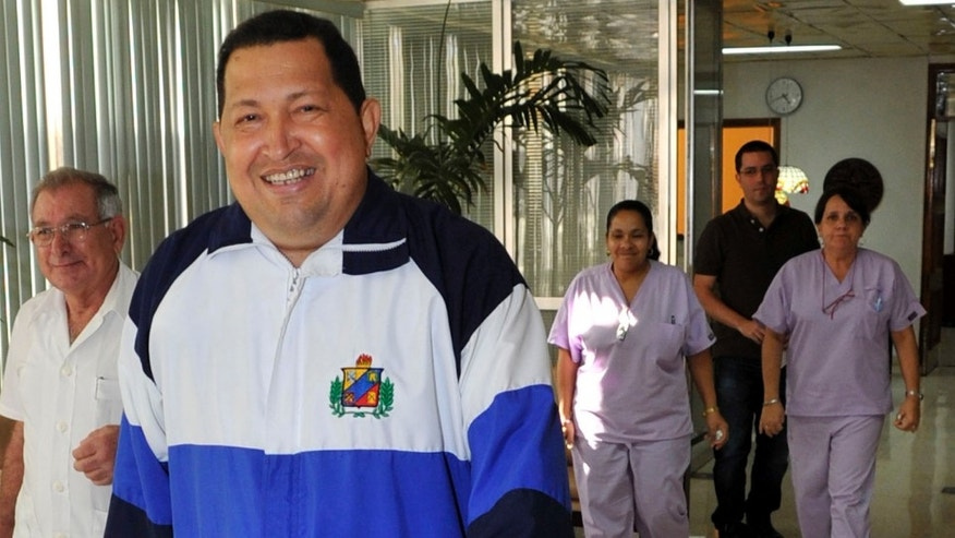 Venezuela's President Hugo Chavez walks in the hospital in Havana, Cuba, Friday March 2, 2012. (AP Photo/Estudios Revolucion)