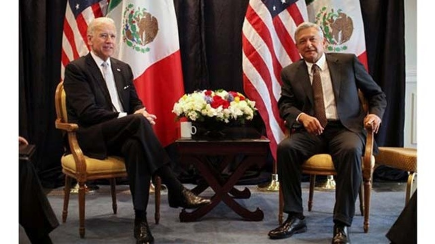 March 5, 2012: U.S. Vice President Joe Biden, left, poses for photos with Mexican presidential candidate Andrés Manuel López Obrador, of the Democratic Revolutionary Party (PRD), Mexico City.