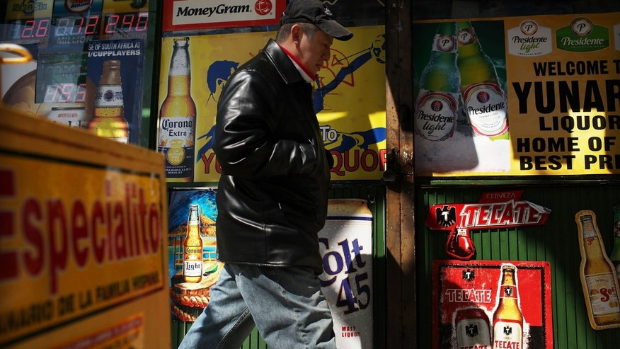 UNION CITY, NJ - MARCH 28: A man walks by adds in Spanish outside of a bodega on March 28, 2011 in Union City, New Jersey. Union City New Jersey, one of the state's largest cities, has a population of Hispanic or Latino origin of over 80%. According to the new 2010 Census Bureau statistics reported last Thursday, the Hispanic population in the United States has grown by 43% in the last decade, surpassing 50 million and accounting for about 1 out of 6 Americans.  (Photo by Spencer Platt/Getty Images)