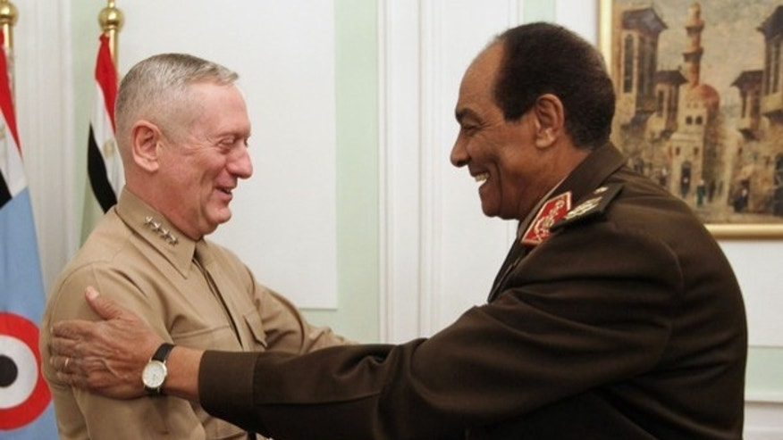 FILE: Egypt's Armed Forces Supreme Council head Field Marshal Hussein Tantawi (R) shakes hands with the U.S. Commander of the Central Command James Mattis as he arrives for a meeting in Cairo.