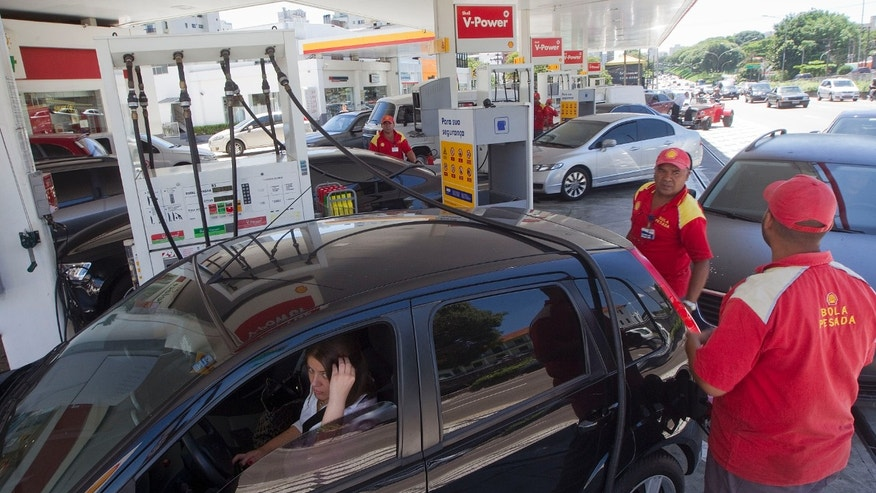Mar. 7, 2012: A gas station employee fills the tank of a customer at a gas station in Sao Paulo, Brazil.