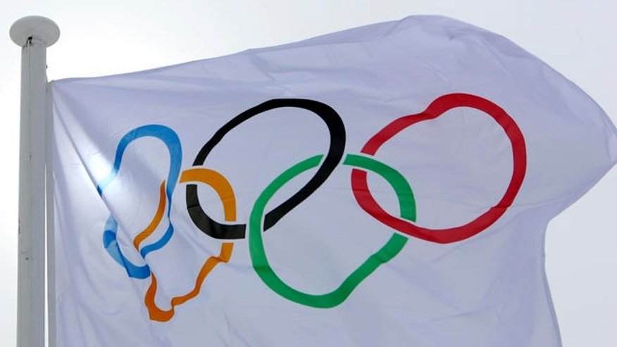 The Olympic flag flutters in the wind after the Nordic Combined team competition at the Turin 2006 Winter Olympic Games had to be cancelled due to the strong wind in Pragelato Plan, Italy, Wednesday, Feb 15, 2006. (AP Photo/Jens Meyer)