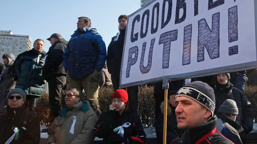 Mar. 10, 2012: A Russian protester holds a poster during a rally in Moscow, Russia.