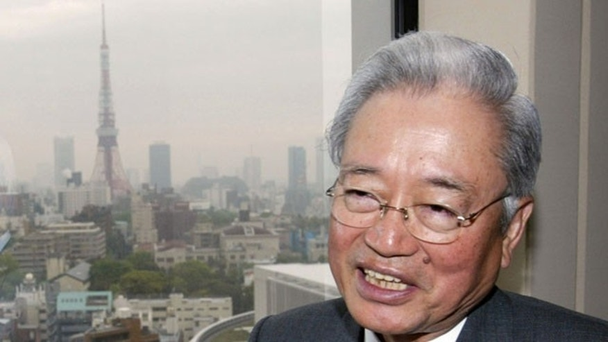 In this April 21, 2003 file photo, Mori Building Co. President Minoru Mori, the developer of the $2.3 billion Roppongi Hills, gestures during the presentation to the media of the sprawling new development with luxury housing and designer shops in the heart of Tokyo.