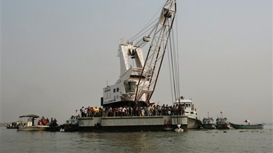 March 13: Rescuers search for victims of a ferry accident on the Meghna River in Munshiganj district, about 20 miles south of Dhaka.