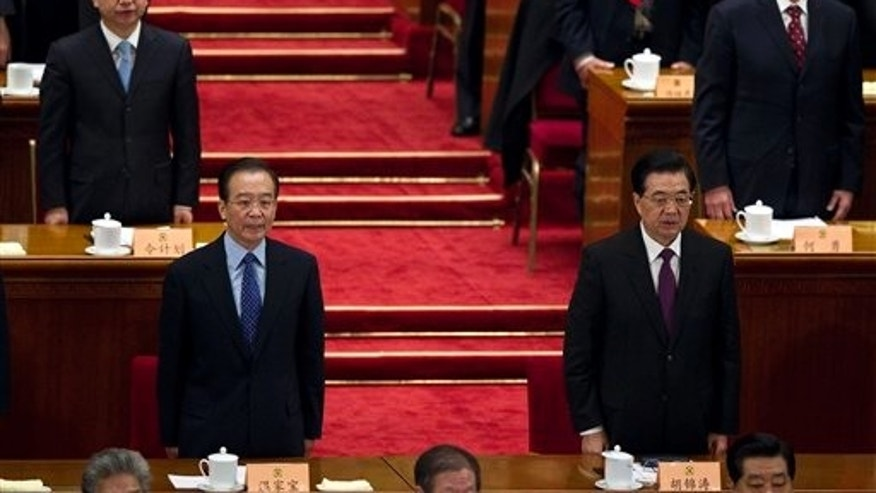 March 13: Chinese President Hu Jintao, front right, and Chinese Premier Wen Jiabao, front left, sing Chinese national anthem with delegates and other leaders during the closing session of the Chinese People's Political Consultative Conference held in Beijing's GreatHall of the People, China.