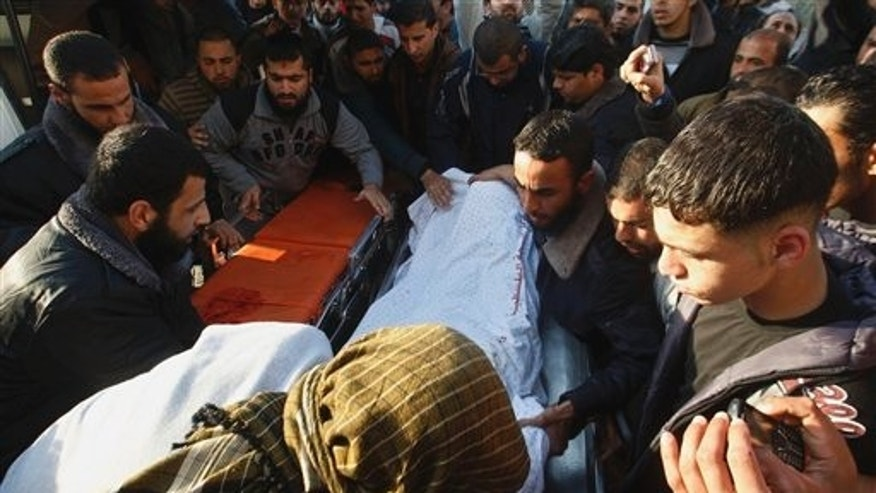 March 9: Palestinian carry the body of  Zuhair al-Qaissi, a  commander of the armed wing of the Popular Resistance Committees (PRC) in Gaza City.