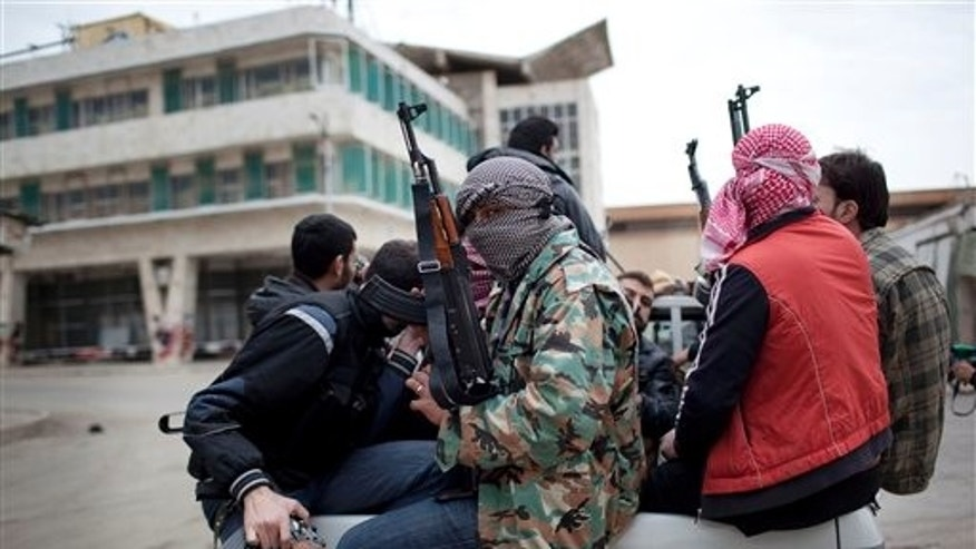March 11: Free Syrian Army fighters prepare fight approaching Syrian Army tanks in Idlib, north Syria.