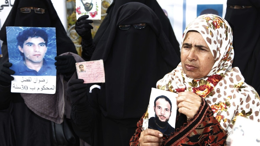 March 15, 2012: Women hold up pictures of their relatives, religious and political prisoners who are on hunger strike in Moroccan jails, as they take part in a protest to demand their release in Rabat.