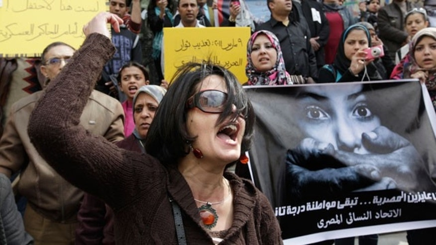 Mar. 16, 2012: An Egyptian activist shouts anti-military Supreme Council slogans during a demonstration in front of Cairo's high court, Egypt.