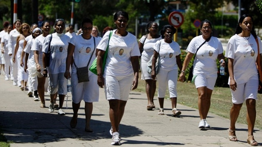 March 18, 2012: Members of dissident group Ladies in White take part in their weekly march in front of Santa Rita church in Havana, Cuba.