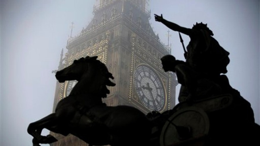 March 15, 2012: The Boudica statue stands in the foreground as fog shrouds the clock tower which houses the 'Big Ben' bell of the Palace of Westminster in London.
