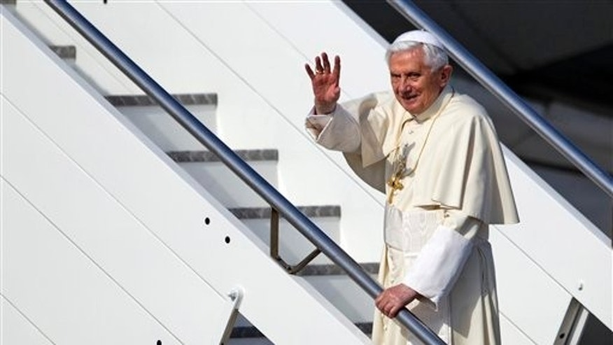 March 23, 2012: Pope Benedict XVI waves as he boards a plane on his way to a six-day visit to Mexico and Cuba, at Rome's Fiumicino international airport.