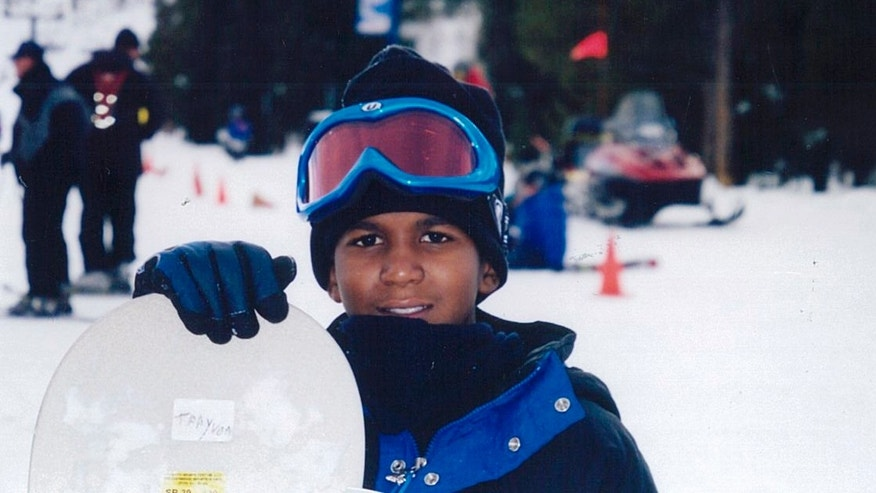 FILE - This undated file photo provided by the Martin family, shows Trayvon Martin snowboarding. Martin was slain in the town of Sanford, Fla., on Feb. 26 in a shooting that has set off a nationwide furor over race and justice. (AP Photo/Martin Family, File)