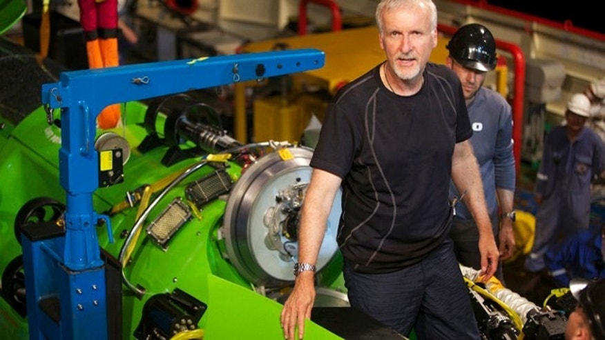 James Cameron emerging from the hatch of DEEPSEA CHALLENGER during testing of the submersible in Jervis Bay, south of Sydney, Australia.