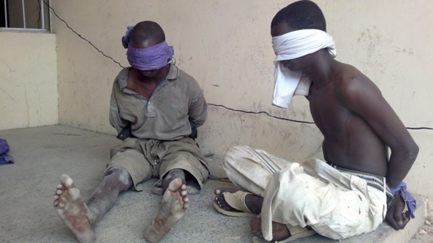 Mar. 21, 2012: Suspected members of the radical Islamist sect Boko Haram, are detained by the military, in Bukavu Barracks in Kano state, Nigeria.