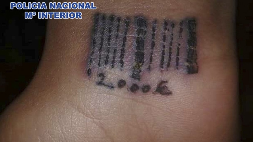 In this photo released by the Spanish Police on Saturday March 24, 2012 a tattoo in the form of a bar code is seen on the wrist of a woman in this hand out photo. Spain´s Interior Ministry says police have arrested 22 persons of Romanian nationality on suspicion of using violence to force women into prostitution and tattooing them with bar codes as a sign of ownership. Officers freed one 19-year-old woman who had been beaten, held against her will and tattooed with a bar code and an amount of money which investigators believe was the debt the gang wished to extort before freeing her. The women were tattooed on their wrists, and the freed woman had the sum 2,000 euro ($ 2,650) etched onto her skin. (AP Photo/Spanish Police)