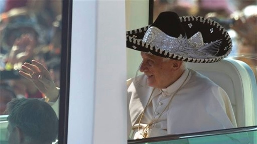 March 25, 2012: Pope Benedict XVI waves from the popemobile wearing a Mexican sombrero as he arrives to give a Mass in Bicentennial Park near Silao, Mexico.