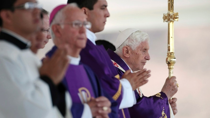 Pope Benedict XVI holds the pastoral staff as he celebrates Mass in Bicentennial Park near Silao, Mexico, Sunday March 25, 2012. (AP Photo/Gregorio Borgia)