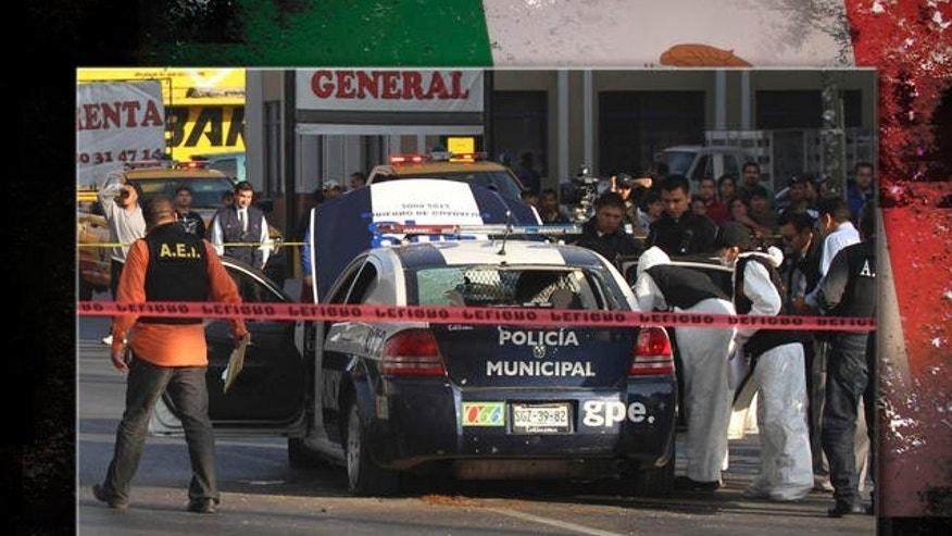 "Mexican army soldiers escort a 14-year-old suspected of working as a killer for a drug cartel in the city of Cuernavaca, Mexico,  Friday Dec. 3, 2010. The much-rumored alleged young assassin nicknamed ""El Ponchis'' was captured late Thursday at the airport in Cuernavaca with his 16-year-old sister as they were trying to catch a flight to Tijuana and flee the country to San Diego.(AP Photo/Antonio Sierra)"
