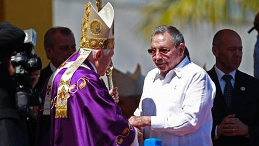 March 28, 2012: Cuba's President Raul Castro greets Pope Benedict XVI at the end of an open-air Mass at Revolution Square in Havana, Cuba.
