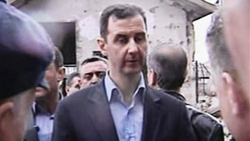 March 27, 2012: In this image made from video, Syrian President Bashar Assad visits Baba Amr neighborhood in Homs, Syria.