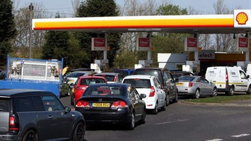 March 29, 2012: Drivers queue for petrol and diesel at a fuel station in Gateshead, England.