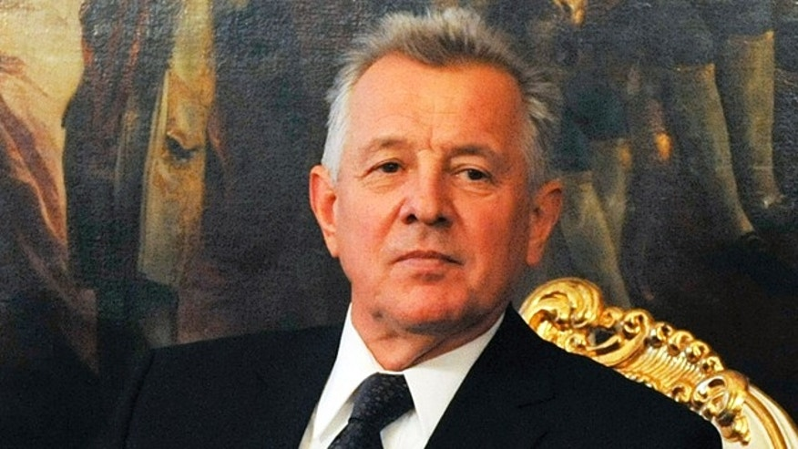 FILE - In this Oct. 20, 2011 file photo Hungarian President Pal Schmitt sits at the Hofurg Palace for talks with Austrian President Heinz Fischer, not pictured, in Vienna, Austria. A Hungarian university decided Thursday to revoke the doctorate of the country's president after an investigation found that large parts of his 1992 thesis were copied from other authors.
