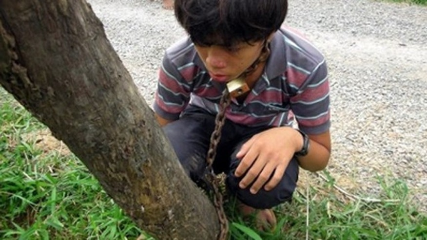 Sok Thoeun, 40, reportedly chained his 13-year-old son to a tree as punishment for skipping school to play online games.