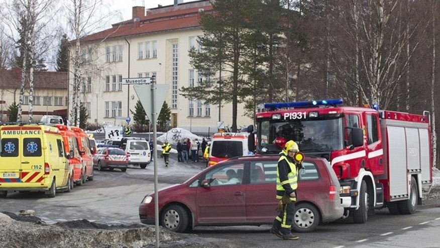 March 30, 2012: Emergency vehicles stand outside a secondary school in Orivesi, Finland. A gunman was arrested after firing several shots at the school in southern Finland but no one was injured in the incident, police said Friday.