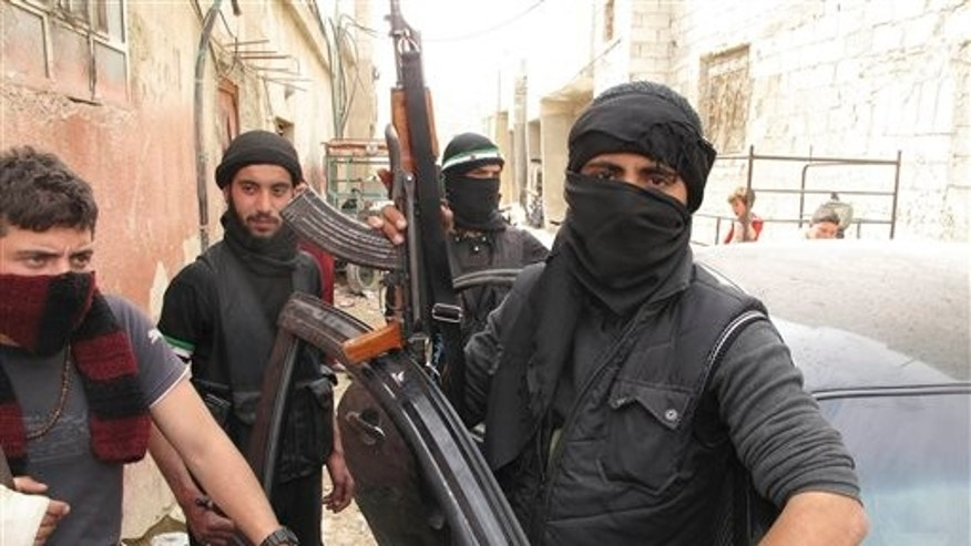 April 1, 2012: Free Syrian Army fighters are seen in a neighborhood of Damascus, Syria.