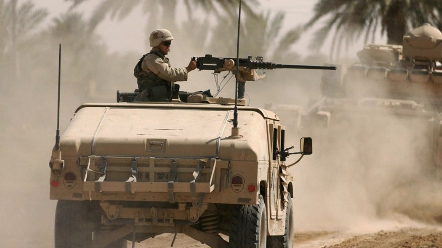 FALLUJAH, IRAQ - JUNE 16:  A U.S. Soldier mans the machine gun on a humvee June 16, 2003 on the outskirts of Fallujah, 70 km south of Baghdad in Iraq. U.S. forces are acting as part of Operation Desert Scorpion, an operation targeting U.S. led coalition opponents in Iraq. It followed the expiration on Sunday of an amnesty program for people turning in heavy weapons. (Photo by Marco Di Lauro/Getty Images)