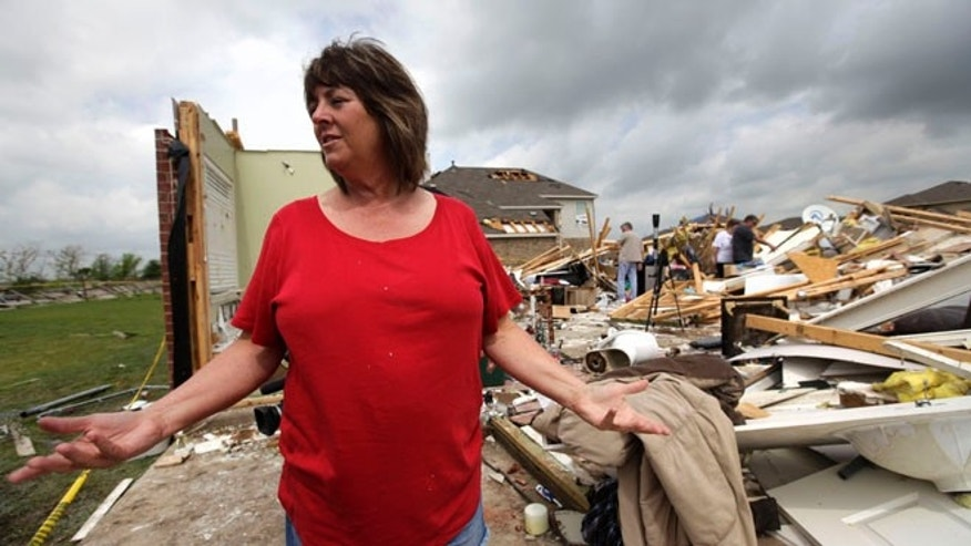 Sherry Enochs, stands in what is left of her home as she recounts the tornado that struck her home Wednesday, April 4, 2012, in Forney, Texas.  (AP Photo/Tony Gutierrez)