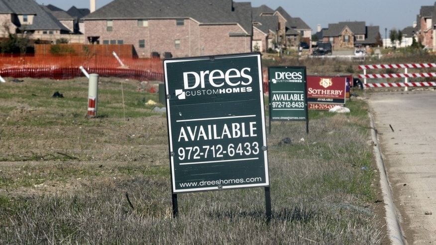 Lots for sale are advertised in a new exurb of Dallas November 17, 2006 in Frisco, Texas. (Photo by Brian Harkin/Getty Images)