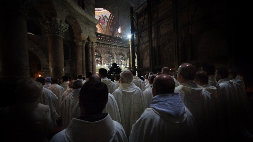 Apr. 5, 2012: Catholic clergy attends the Washing of the Feet ceremony during the Easter Holy Week inside the Church of the Holy Sepulchre, traditionally believed to be the burial site of Jesus Christ, in Jerusalem's Old City.