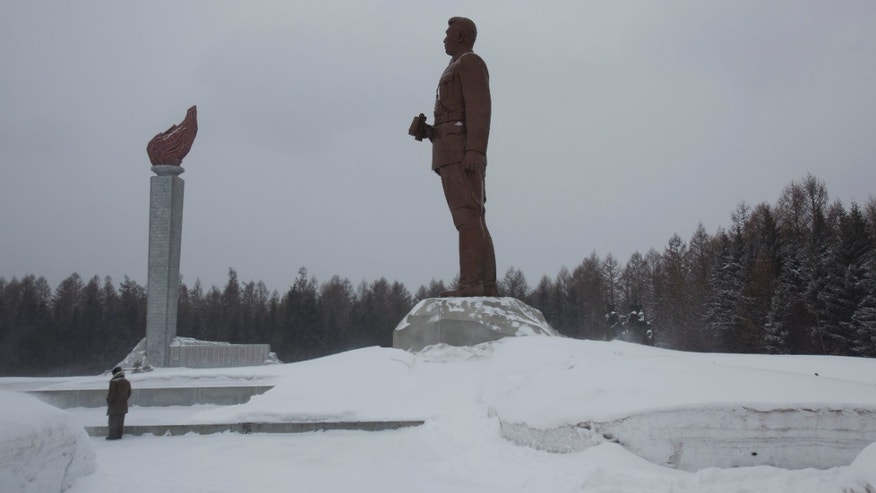 April 3, 2012: A bronze monument of the late North Koran leader Kim Il Sung stands at the Samjiyon Grand Monument area in Samjiyon, North Korea at the base of Mount Paektu.