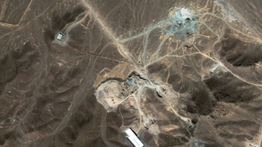 A file satellite image taken Sunday Sept. 27, 2009, provided by DigitalGlobe, shows a suspected nuclear enrichment facility under construction inside a mountain located north of Qom, Iran. Critical nuclear talks between Iran and world powers could begin this week in an atmosphere of impasse.