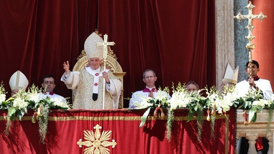 April 8: Pope Benedict XVI greets the faithful after the Urbi and Orbi blessing at the end of the Easter Mass in St. Peter's Square at the Vatican.
