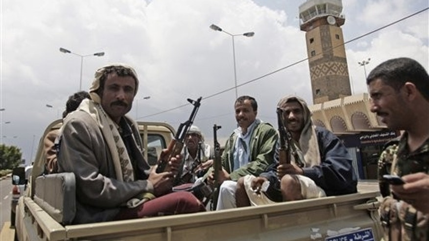 April 8, 2012: Yemeni policemen sit in a pickup truck in front of Sanaa'ss International airport in Yemen. Yemen's main airport reopened on Sunday, a day after gunmen loyal to the nation's former president seized the facility in the capital Sanaa, officials said. Saturday's assault on the airport involved armed tribesmen along with troops in uniform. Driving pickup trucks mounted with anti-aircraft guns, they blasted buildings of Yemen's main airport and opened fire on one of the airport surveillance towers before surrounding the entire complex, blocking roads and turning away passenger vehicles.