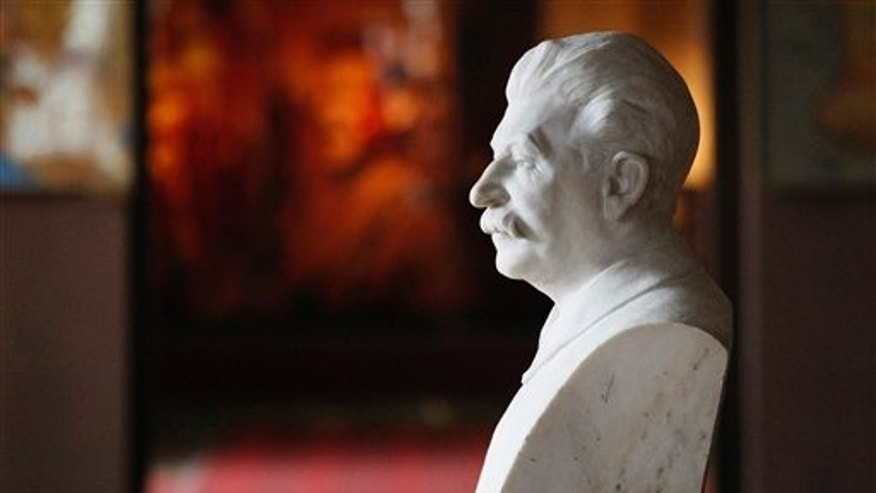 April 9, 2012: A bust of Soviet dictator Josef Stalin sits inside a museum dedicated to him in the town of Gori, some 80 kilometers (50 miles) west of the Georgian capital Tbilisi. A museum that has honored Josef Stalin in Georgia since 1937 is being remodeled to exhibit the atrocities that were committed during the Soviet dictator's rule.