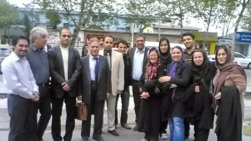 11 of 12 Christians who stood trial in Iran on Easter Sunday with a family member and their attorney.